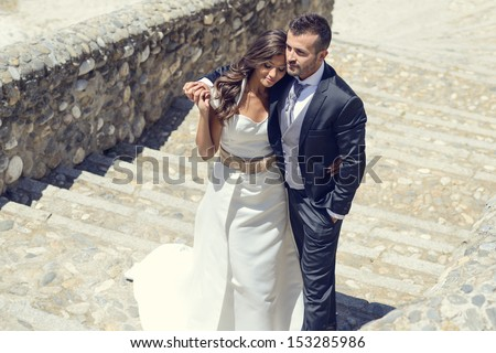 Just married couple together in urban background