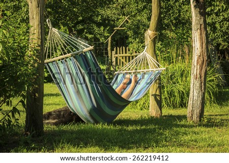 Just relax. Relaxation in the garden during holiday after work. - stock photo