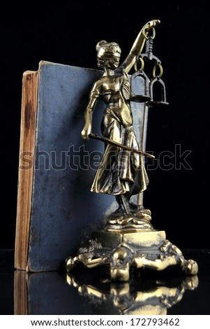 Justice Lady and old book. Lawyer background - stock photo