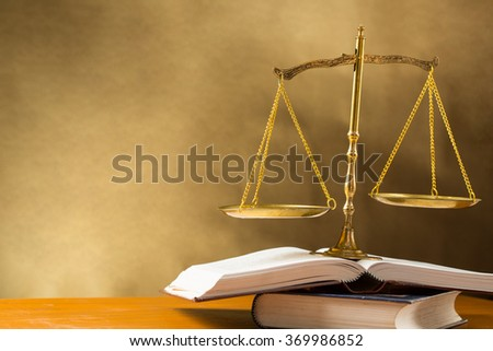 Justice of scale on table. - stock photo