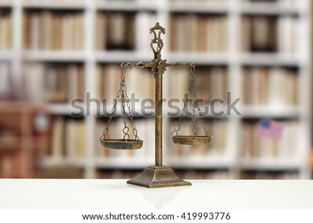 Justice Scale on white table