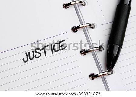 JUSTICE word written on notebook - stock photo