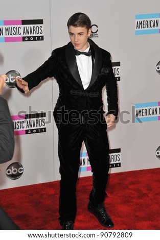 Justin Bieber arriving at the 2011 American Music Awards at the Nokia Theatre, L.A. Live in downtown Los Angeles. November 20, 2011  Los Angeles, CA Picture: Paul Smith / Featureflash - stock photo
