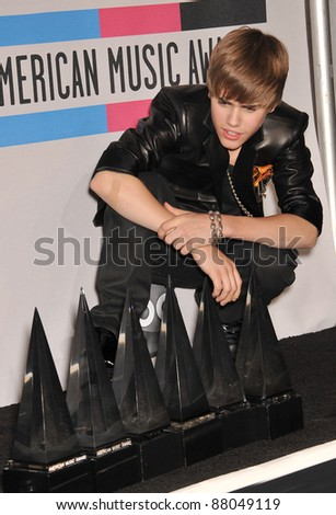 Justin Bieber at the 2010 American Music Awards at the Nokia Theatre L.A. Live in downtown Los Angeles. November 21, 2010  Los Angeles, CA Picture: Paul Smith / Featureflash - stock photo