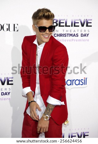 "Justin Bieber at the World premiere of ""Justin Bieber's Believe"" held at the Regal Cinemas L.A. Live in Los Angeles on December 18, 2013 in Los Angeles, California.  - stock photo"