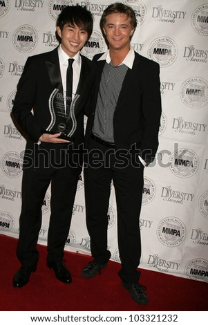 Justin Chon and Michael Welch  at the Multicultural Motion Picture Association's  17th Annual Diversity Awards, Beverly Hills Hotel, Beverly Hills, CA. 11-22-09