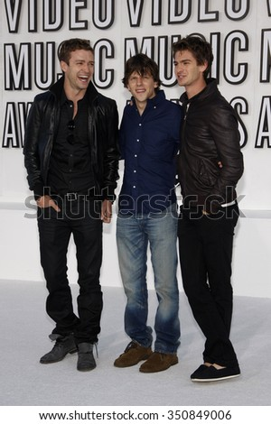 Justin Timberlake, Jesse Eisenberg and Andrew Garfield at the 2010 MTV Video Music Awards held at the Nokia Theatre L.A. Live in Los Angeles, USA on September 12, 2010. - stock photo