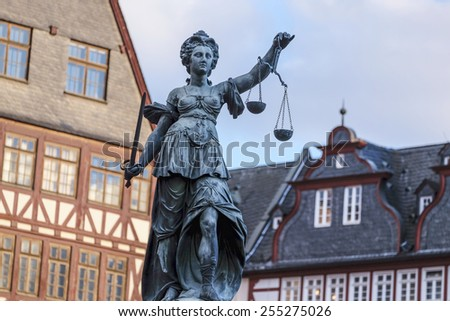 Justitia - Lady Justice - sculpture on the Roemerberg square in Frankfurt, built 1887 - stock photo