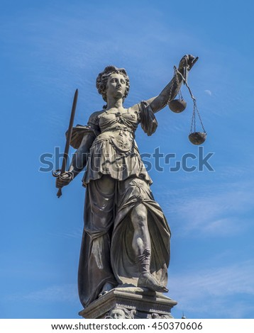 Justitia - Lady Justice sculpture on the Roemerberg squareStatue of Lady Justice (Justitia) in Frankfurt, Germany - stock photo