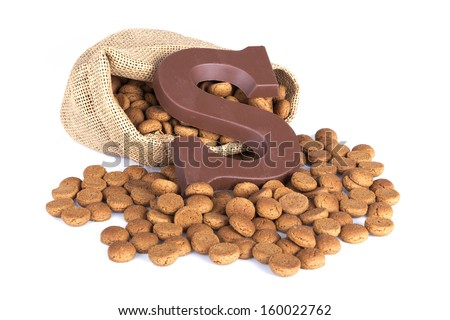 Jute bag with ginger nuts and chocolate; a Dutch tradition at Sinterklaas event in december - stock photo