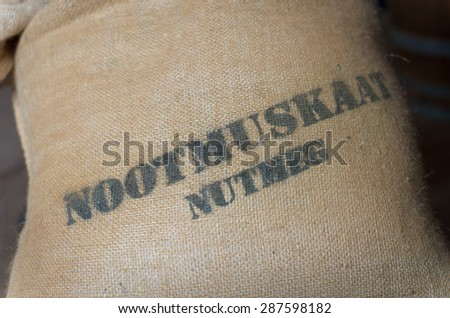 jute bag with nutmeg in it - stock photo