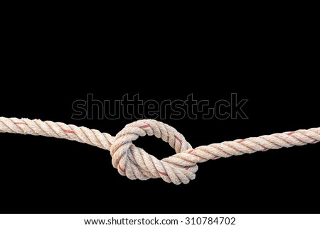 jute rope with knot isolated on black background - stock photo