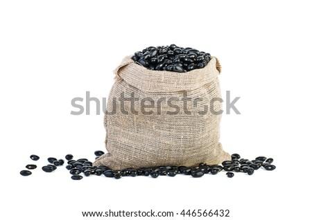 Jute sack with black legume beans isolated on white background - stock photo