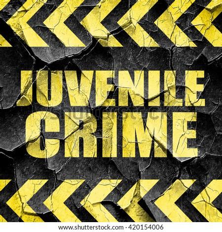 juvenile crime, black and yellow rough hazard stripes - stock photo