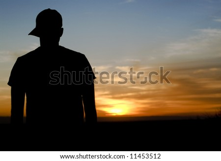 Juvenile watching the sunset. - stock photo