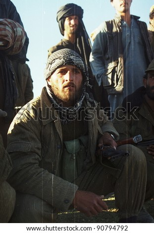 KABUL - OCT 21: Northfoto Alliance fighters prepare for battle with Taliban forces north of Kabul, Afghanistan on Monday, October 21, 1996. Film grain visible.