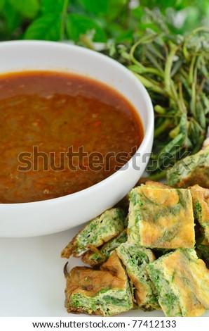 kaeng som, sour soup made of tamarind sauce,kaeng som cha-om kai. - stock photo