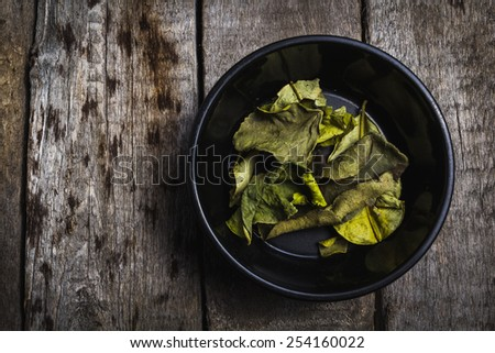 Kaffir Lime spices for prepare tasty food with soft shadow in the wooden background - stock photo