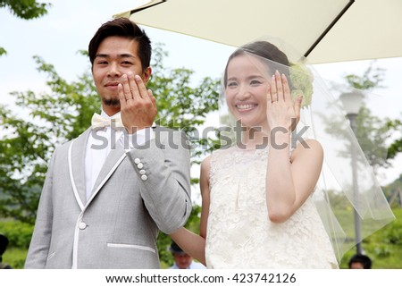 KAGAWA, JAPAN - MAY 15, 2016: Beautiful Japanese wedding couple wedding in Zentuji-Gogakunosato Park. Young wedding couple, beautiful bride with groom portrait. May 15, 2016 in Kagawa, Japan. - stock photo