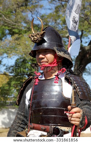 KAGAWA, JAPAN - OCTOBER 25: Ancient firelock rifle fighters at Marugame Historical battle Festival, event dedicated to Japanese culture and tradition at Marugame-castle on October 25, 2015 in Japan.