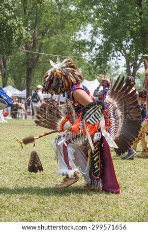 KAHNAWAKE, QUEBEC, CANADA - JULY 12, 2015 : Pow wow dancers take part in Kahnawake 25th Annual Echoes Of A Proud Nation Pow Wow in Kahnawake reserve, Quebec, Canada on July 12, 2015