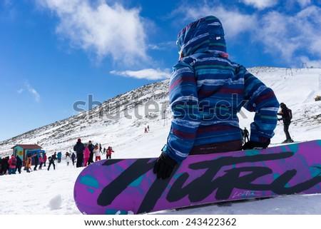 KAIMAKTSALAN, GREECE - FEBRUARY 13, 2014: Skiers enjoy the snow at Kaimaktsalan ski center, in Greece. Recently at the ski center every lift has its automatic ticketing system. - stock photo