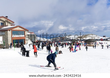 KAIMAKTSALAN, GREECE - FEBRUARY 13, 2014: Skiers enjoy the snow at Kaimaktsalan ski center, in Greece. Recently at the ski center every lift has its automatic ticketing system.