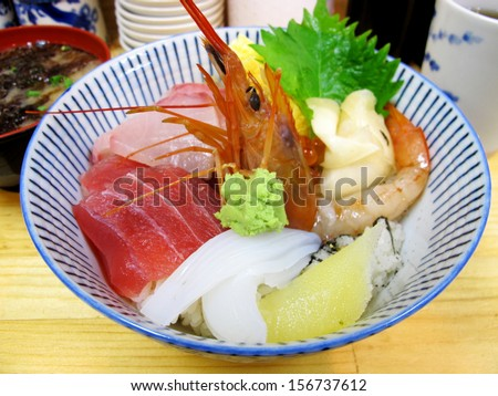 Kaisen don consists of assorted raw seafood on a bowl of sushi rice, or combination of salmon, tuna, shrimp, and squid.