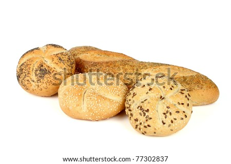 Kaiser rolls with poppy and sesame seeds and a loaf of bread with condiments on white background