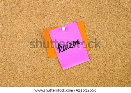 Kaizen written on paper note pinned on cork board with white thumbtack, copy space available - stock photo
