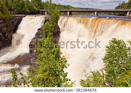 Kakabeka Falls, large powerful waterfall tourist attraction near Thunder Bay, Ontario, ON, Canada - stock photo