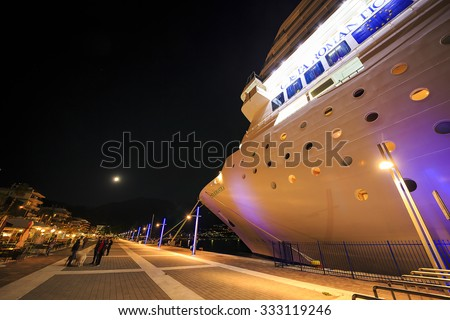 KALAMATA - GREECE OCTOMBER 27 2015: Costa Neoromantica Cruise ship anchored at kalamata port, with a view of the full moon rising over Taygetos mountain at night.