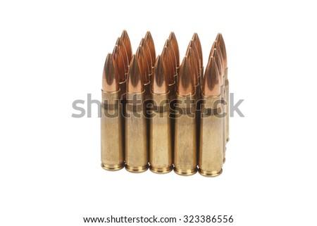 kalashnikov cartridges isolated on white - stock photo