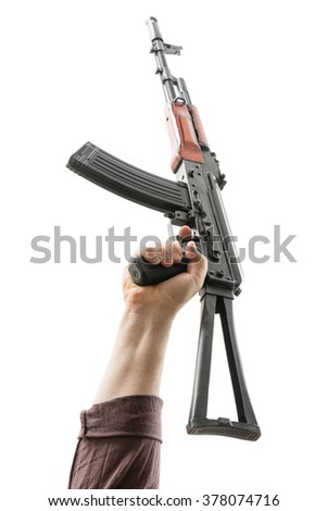 Kalashnikov raised by one hand in a vertical position. Isolated.