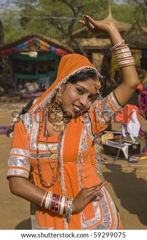 Kalbelia dancer from the Jaipur area of Rajasthan performing at the annual Sarujkund Fair on the outskirts of Delhi, India - stock photo