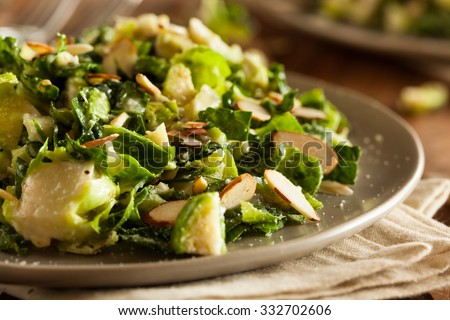 Kale and Brussel Sprout Salad with Almons and Lemon Dressing - stock photo
