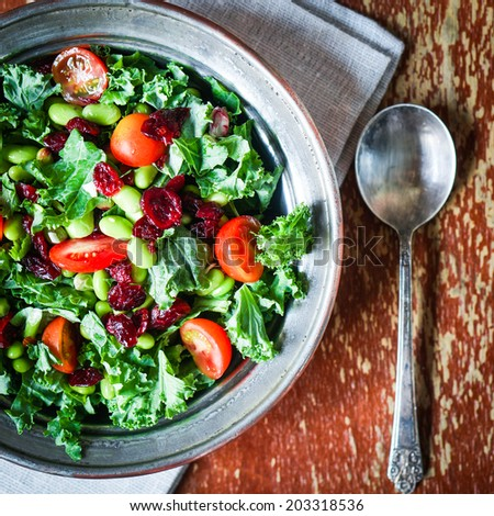 Kale and edamame salad on rustic background - stock photo
