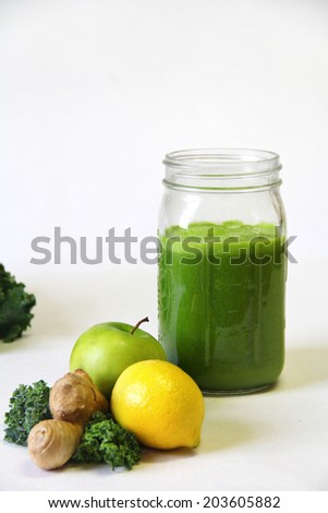 Kale apple lemon ginger juice vertical - stock photo
