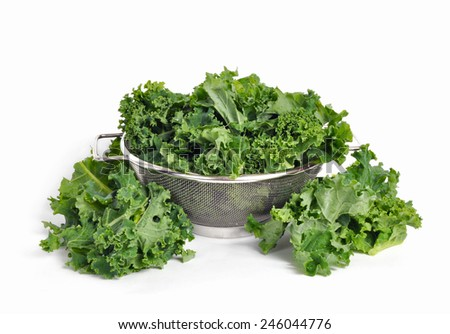 Kale in a bowl on white background