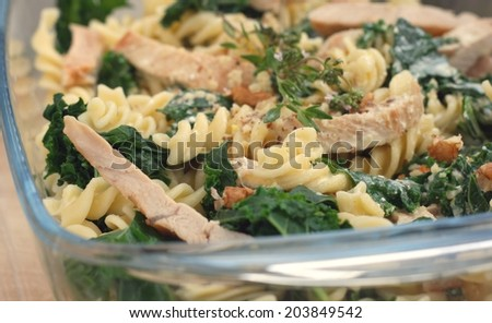 Kale or borecole recipe idea: pasta with walnut, cheese, sour cream, chicken meat and thyme, baked in owen