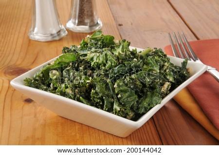Kale salad with cashews, tamari and sesame seeds - stock photo