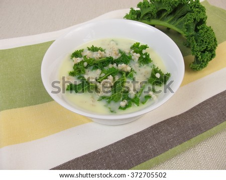 Kale soup with pearl barley - stock photo