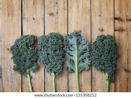 Kale super vegetable on a wooden background - stock photo