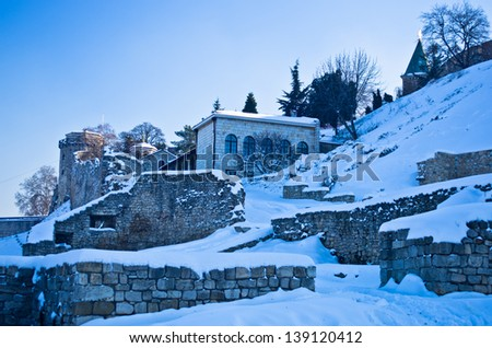 Kalemegdan fortress covered with snow. Fortress is positioned at the confluence of rivers Danube and Sava, at the city of Belgrade, Serbia - stock photo