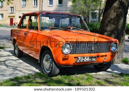 KALININGRAD, RUSSIA - APRIL 23, 2014: Aged soviet motor car VAZ 2101 Zhiguli at the city street.  - stock photo