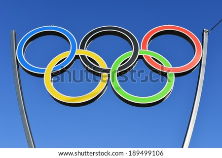 KALININGRAD, RUSSIA - APRIL 26, 2014: the Olympic rings on the square opposite the sports complex Yunost, on blue sky - stock photo