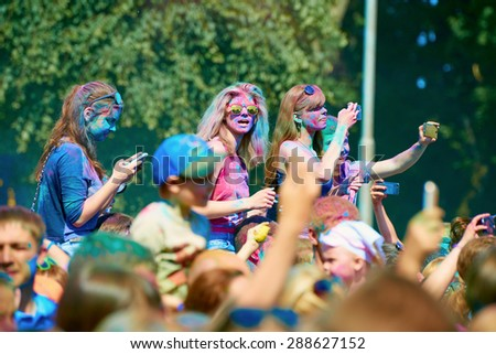 KALININGRAD, RUSSIA - JUNE 12, 2015: Unidentified people during Holi Festival of Colors, the event is timed to the Day of Russia. - stock photo