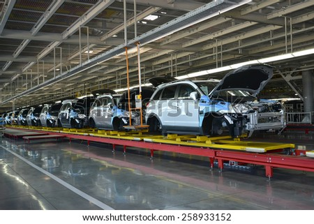KALININGRAD, RUSSIA - SEPTEMBER 16, 2014: Cars stand on the conveyor line of assembly shop. Automobile production - stock photo