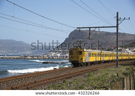 KALK BAY WESTERN CAPE SOUTH AFRICA - APRIL 2016 - The scenic coastal suburban railroad line which runs between Cape Town and Simon's Town seen here passing Kalk Bay in the Western Cape Southern Africa