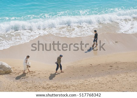 Kalkan, Turkey, May 5, 2016: Groom and bride in a white dress on the beach
